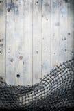 Aún-vida de las redes de pesca en el fondo de madera Imágenes de archivo libres de regalías