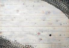 Aún-vida de las redes de pesca en el fondo de madera Fotografía de archivo libre de regalías