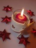 Aún-vida del día de fiesta con la vela Imagenes de archivo