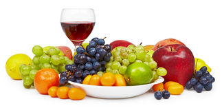 Aún-vida grande con el vidrio de la fruta y de vino Imágenes de archivo libres de regalías