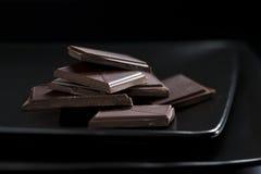Aún-vida oscura con el detalle del chocolate Fotos de archivo