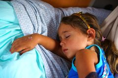 Free A 4 Year Old Girl Sleeps On Her Bed Royalty Free Stock Images - 164367469