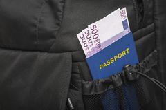 Free A Backpack From Whose Pocket A Passport And Money Are Sticking Out In Euros Stock Images - 121284474