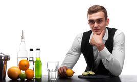 A Bartender Behind A Bar Counter With Ingredients For Cocktails, Isolated On A White Background. Restaurant Service Royalty Free Stock Photo