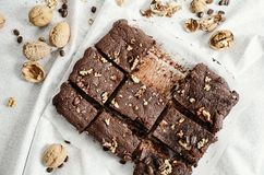 Free A Batch Of Chocolate Brownies With Nuts Cut Into Pieces Royalty Free Stock Photography - 129773447