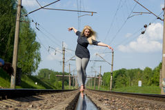 A Beautiful Girl Walking Down The Railroad Track Royalty Free Stock Image