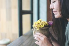 A Beautiful Woman Holding And Smelling Flowers With Feeling Happy Stock Images