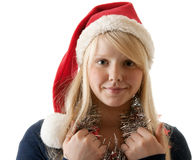 A Beautiful Young Blonde In A Santa Hat Royalty Free Stock Images