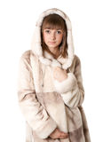 A Beautiful Young Girl In A Fur Coat Royalty Free Stock Images