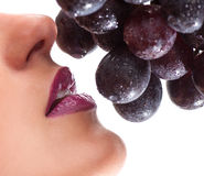 A Beautiful Young Woman Face With Grape Royalty Free Stock Photography
