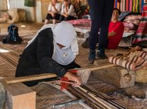 Free A Bedouin Woman Shows How To Make The Right Fabric On A Simple Loom In A Bedouin Village Near The Mitzpe Ramon City Royalty Free Stock Photo - 160172825
