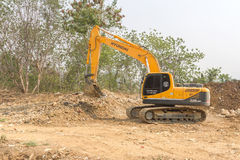 Free A Big Excavator Earthmoving Works On New Construction Site Royalty Free Stock Photo - 70303905