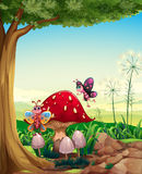 A Big Mushroom Near The Tree With Butterflies Stock Image