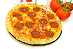 A Big Pizza With Cheese,salami,tomatoes Royalty Free Stock Image