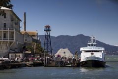 A Boat Disembarks Tourists On The Island Of Alcatraz. San Francisco Bay Royalty Free Stock Images