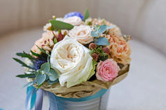 Free A Bouquet Of Flowers In A Bucket Royalty Free Stock Image - 69539086