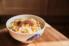 A Bowl Of Chinese Fried Rice With Pork Sausages And Vegetables. Royalty Free Stock Photo