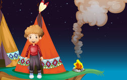 A Boy Camping At The Cliff In The Middle Of The Night Stock Image