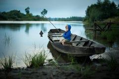 Free A Boy Is Fishing Stock Photo - 102328810