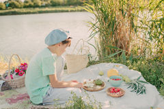 A Boy On The River Bank Royalty Free Stock Photo