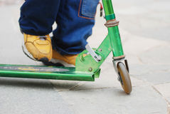 A Boy Playing With Pedal Cycle Royalty Free Stock Image