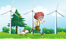 A Boy Running With A Dog Near The Three Windmills Royalty Free Stock Photos