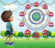 A Boy Watching The Ferris Wheels Royalty Free Stock Photo