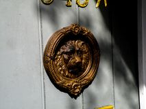 Free A Brass Door Knocker Hangs On The Door Of A Home In The New Orleans French Quarter Royalty Free Stock Photos - 120233658