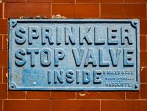 Free A British `sprinkler Stop Valve Inside` Metal Wall Plate Sign. Royalty Free Stock Image - 182981576