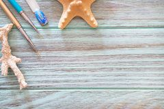 A Brown Background With A Starfish And Nails. Royalty Free Stock Photo
