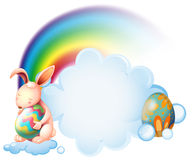 A Bunny Hugging An Easter Egg Near The Rainbow Royalty Free Stock Photo