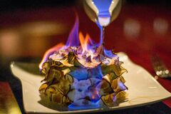Free A Burnt Alaska Or Bombe Alaska Flambe On A Plate With Berries On The Side Royalty Free Stock Image - 198309486