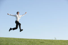A Business Man Jumping For Joy Stock Images
