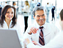 Free A Business Team Of Three Sitting In Office Royalty Free Stock Images - 40140159