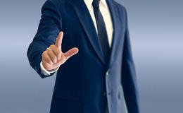 Free A Businessman Is Standing And Pointing Hand. Stock Photo - 122207560