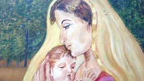 Free A Canvas Painting Of A Mother And Son. Stock Photography - 138617892