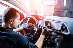 Free A Car Service Worker Cleans The Car Console With A Special Brush Royalty Free Stock Photos - 217613348