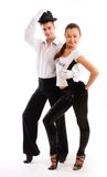 A Charming Pair Dances In Good-looking Suits Royalty Free Stock Image