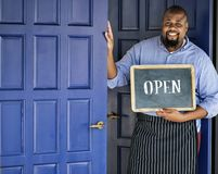 Free A Cheerful Small Business Owner With Open Sign Stock Photo - 114744420