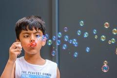 Free A Child Blowing Soap Bubbles; Casual Portrait Stock Image - 218855521