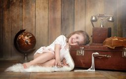 Free A Child In A Retro Interior And An Old Phone Sits On The Floor. Stock Images - 109659834