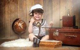 Free A Child In A Retro Interior And An Old Phone Sits On The Floor. Royalty Free Stock Images - 111350379