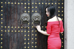 A Chinese Woman In Red Dress In Feng Jing Ancient Town Royalty Free Stock Image