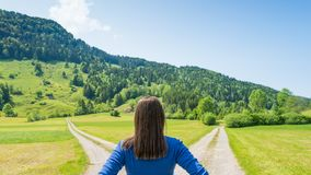Free A Choice Of Two Ways. Woman At A Crossroads Stock Photos - 165444543