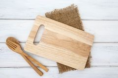 Free A Chopping Board And Tablecloth With Wooden Fork And Spoon On W Stock Image - 132120381