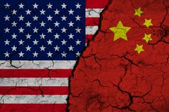 Free A Closeup View Of The US Flag And The Flag Of China Against The Backdrop Of Cracked Earth. The Concept Of The Crisis Of The War Of Stock Photography - 170391862