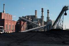 A Coal Fired Power Plant With Coal Yard Stock Photography