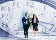 A Collage Of The Time Concept And A Couple Of Business Persons Stock Photo