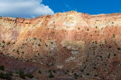 Free A Colorful Desert Cliff Face Illuminated A Break In The Clouds Stock Photos - 179076783