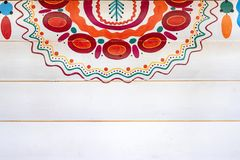 A Colorful Fragment Of The Russian Pattern In The Style Of Dymkovo On Wooden Wall Painted In White Royalty Free Stock Image